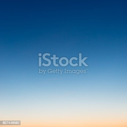 istock Graduated colours at dusk in photograph of sky 807448582
