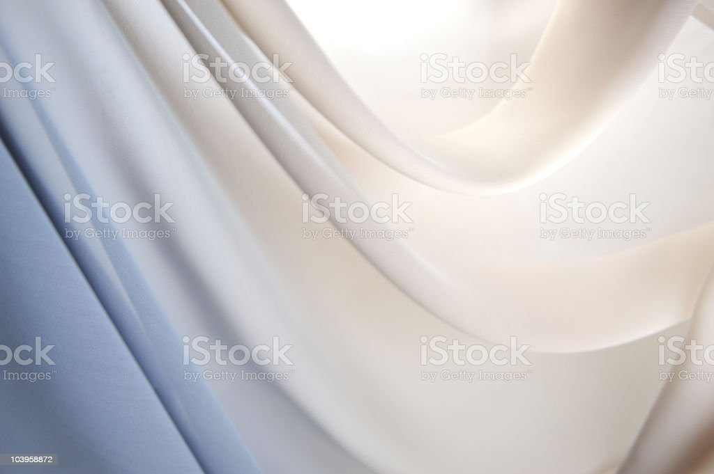 Graduated silk from blue to white stock photo