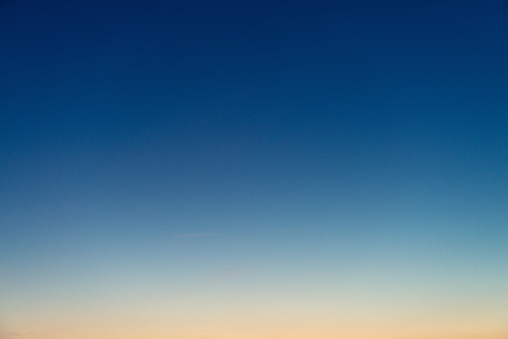 Genuine photograph of a graduated sky at dusk, with colours ranging from deep blue to pinky-orange.