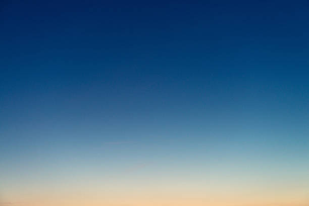 Graduated twilight horizon sky Genuine photograph of a graduated sky at dusk, with colours ranging from deep blue to pinky-orange. twilight stock pictures, royalty-free photos & images