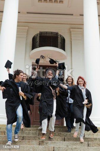 istock Graduates cheering on campus 142021428