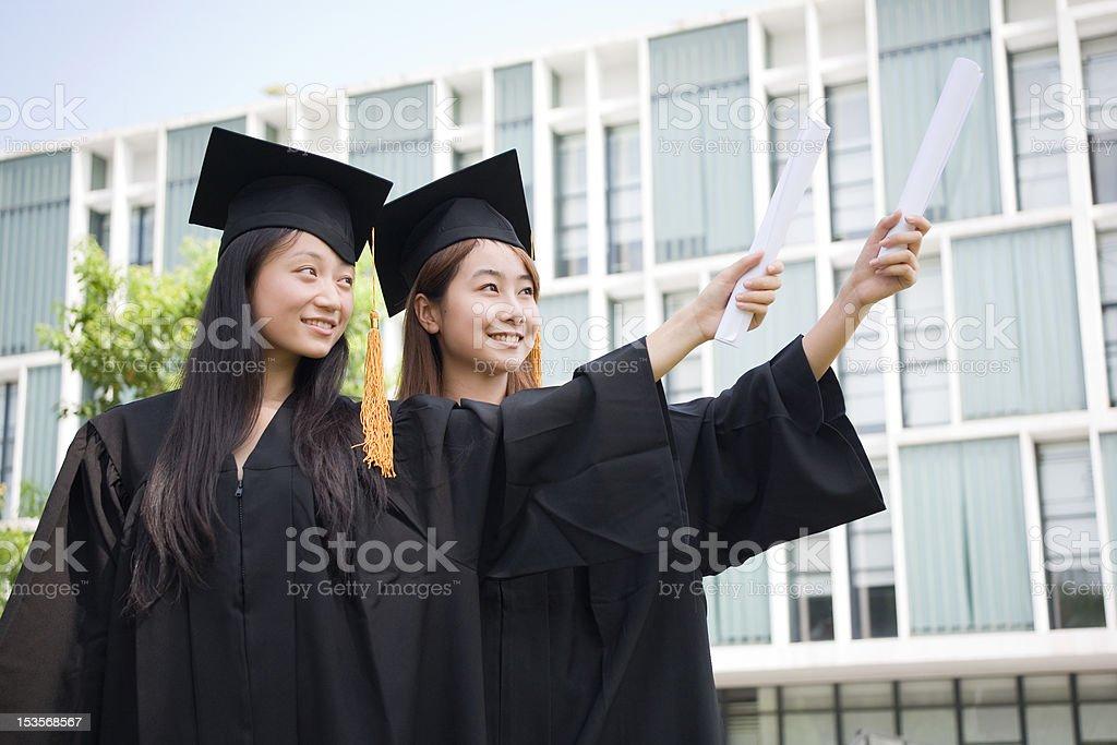 Graduates hand certificate royalty-free stock photo