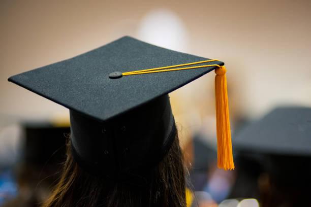Graduates in graduation ceremony stock photo