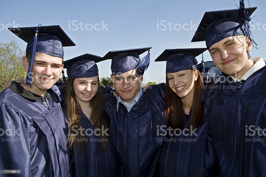 Graduates posing to a picture royalty-free stock photo