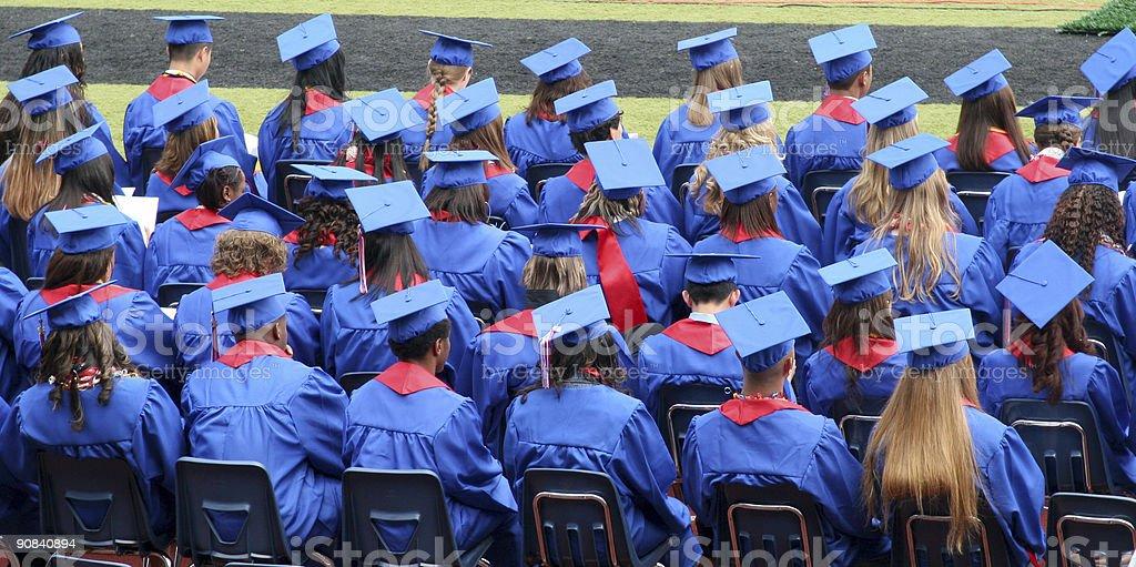 graduates sitting stock photo