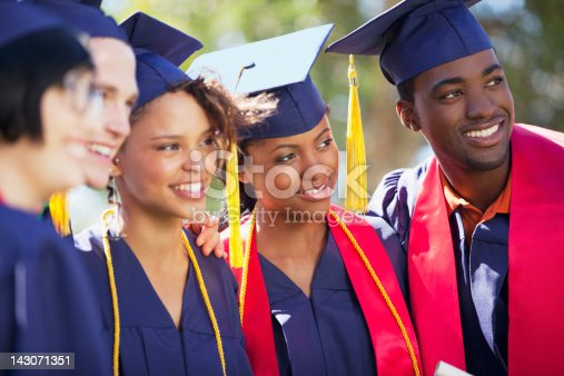 istock Graduates smiling together in cap and gown 143071351