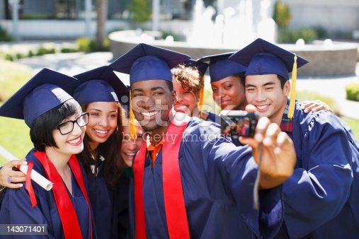143071519 istock photo Graduates taking picture of themselves 143071401