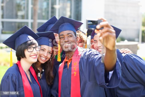 istock Graduates taking picture of themselves 168116914