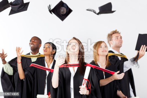 istock graduates throwing caps 153974905