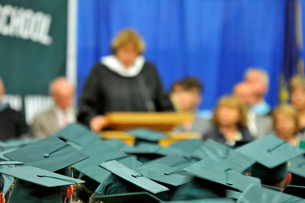 graduating class sea of mortar boards - mike cherim stock pictures, royalty-free photos & images