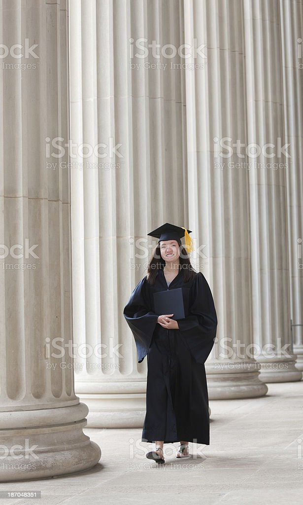 Graduating Woman Student Walking on College Campus Vertical royalty-free stock photo