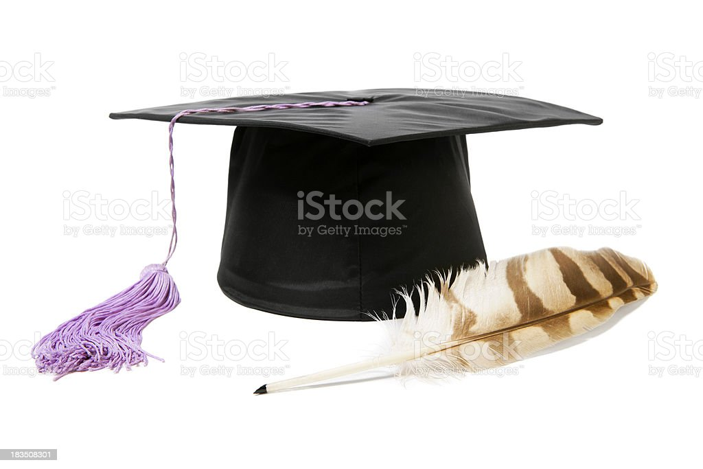 Graduation cap and a quill royalty-free stock photo