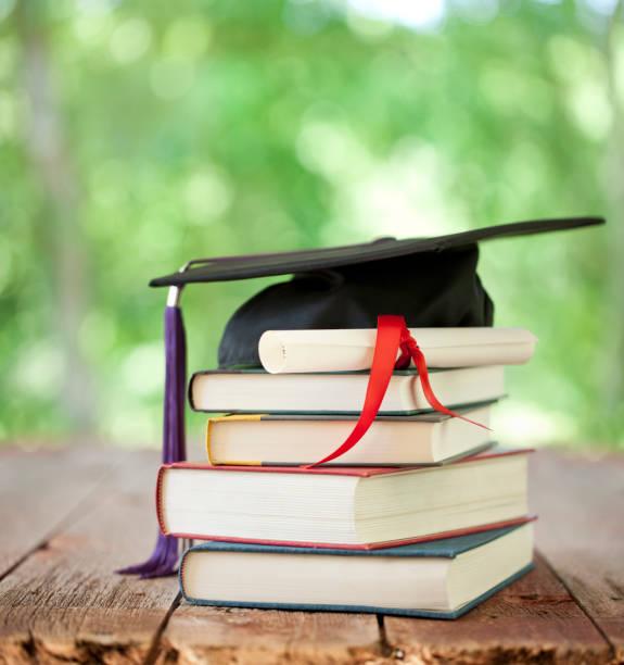 Graduation Cap and Diploma Concept stock photo