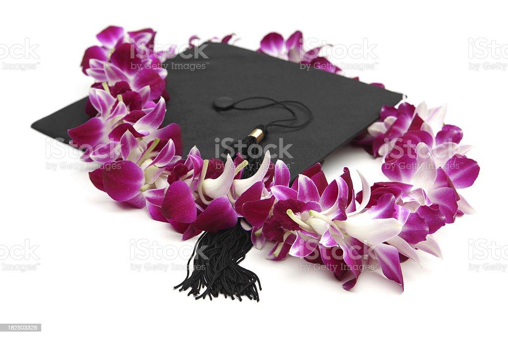 Tapa de graduación y Lei - foto de stock