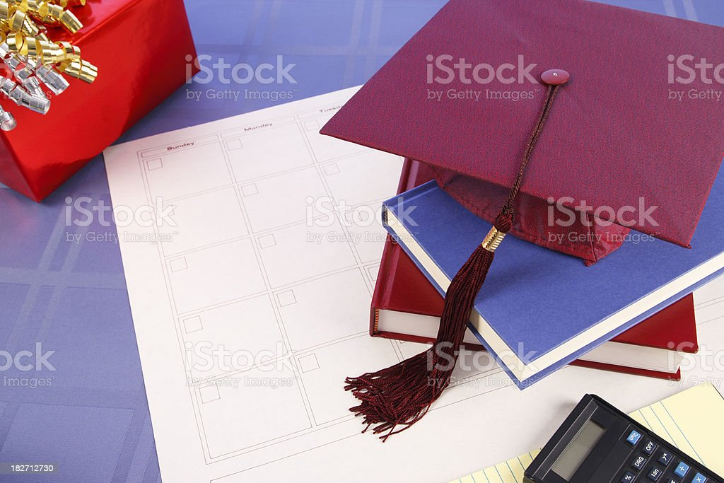 Graduation Cap, Books, Gift Over Calendar Grid with Copy Space stock photo