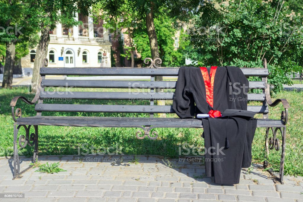 Graduation Cap Hat With Black Tassel Mantle With A Degree Of Paper