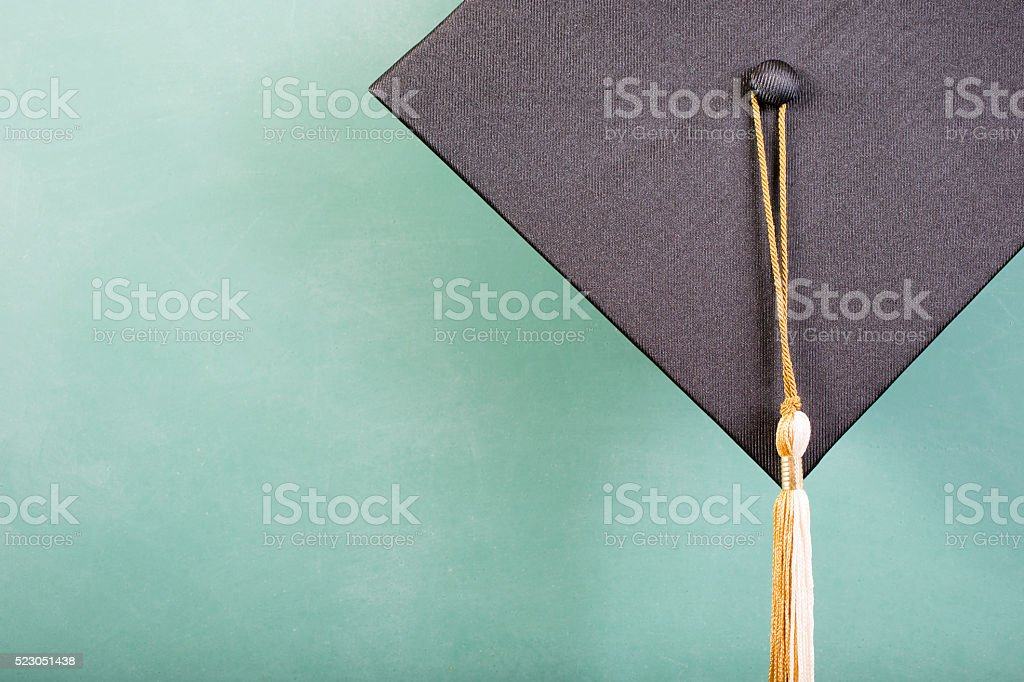 Graduation!  Cap, motarboard, green chalkboard. Education background. stock photo