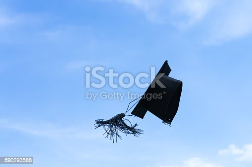 1009462356 istock photo Graduation cap or mortar board thrown up to the sky 590293588