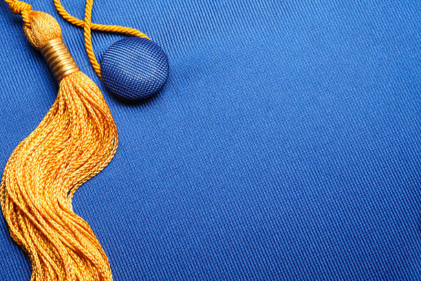 Graduation Cap A close up of a graduation cap and tassel.To see more of my education images click on the link below tassel stock pictures, royalty-free photos & images
