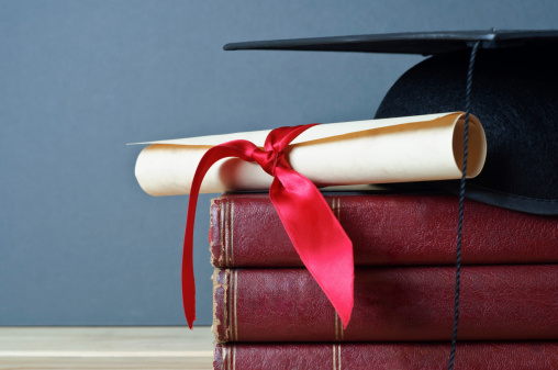 Graduation Cap Scroll And Books Stock Photo - Download Image Now