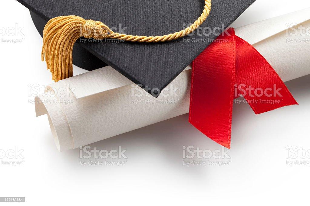 Graduation cap with diploma stock photo