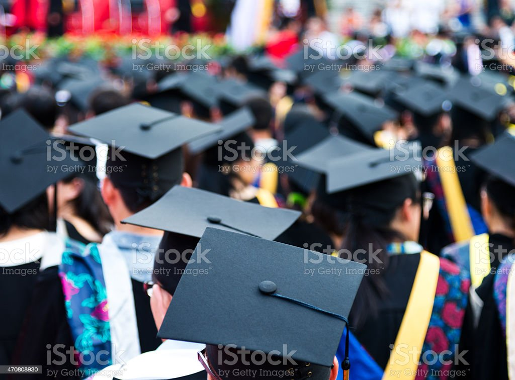 graduation caps during commencement stock photo