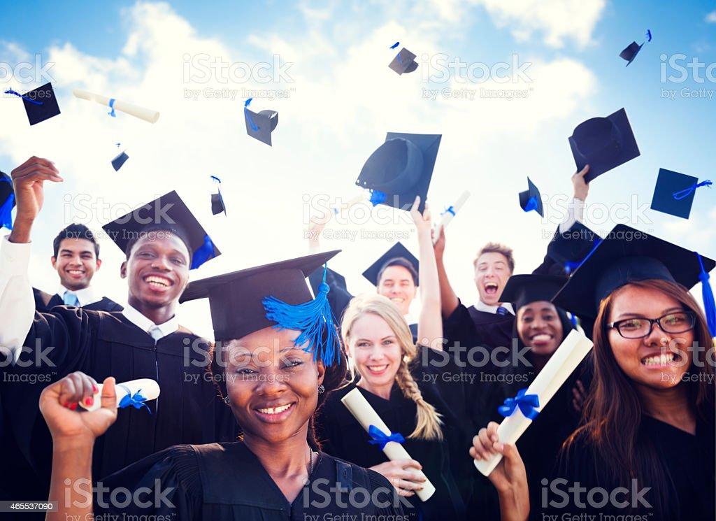 Graduation Caps Throwing Air Concept stock photo