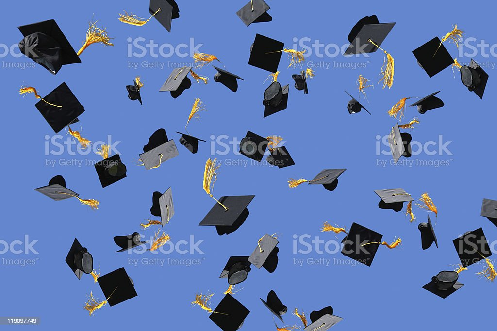 Graduation caps thrown into air stock photo