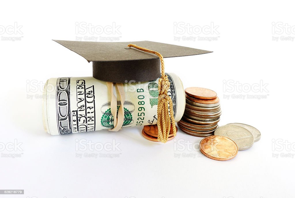 graduation cash and coins stock photo