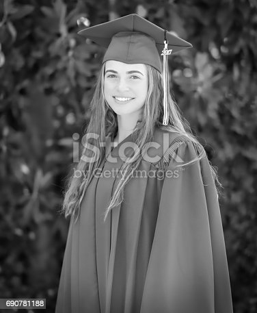 Young woman gets ready for graduation ceremony