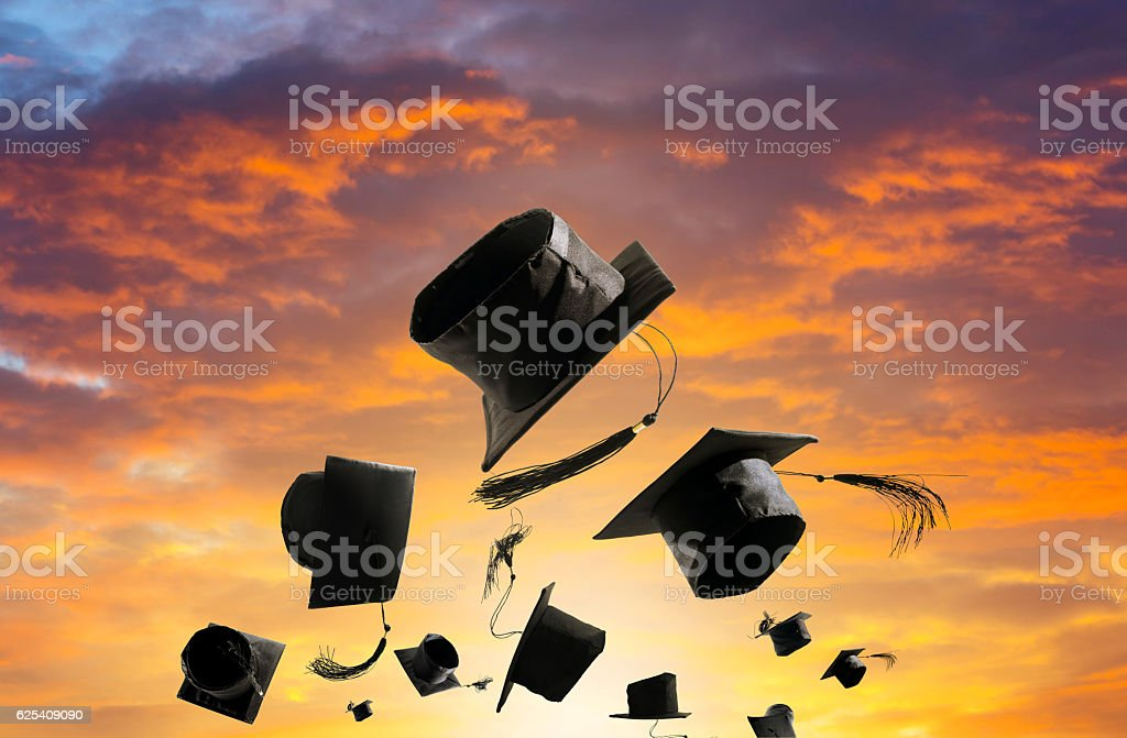 Graduation Ceremony, Graduation Caps, hat Thrown in the Air suns stock photo