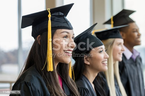A multi-ethnic group of students is excited to graduate.