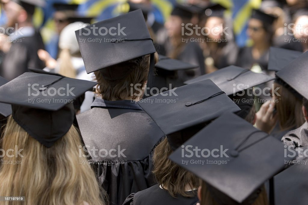 Graduation day with many students wearing caps royalty-free stock photo