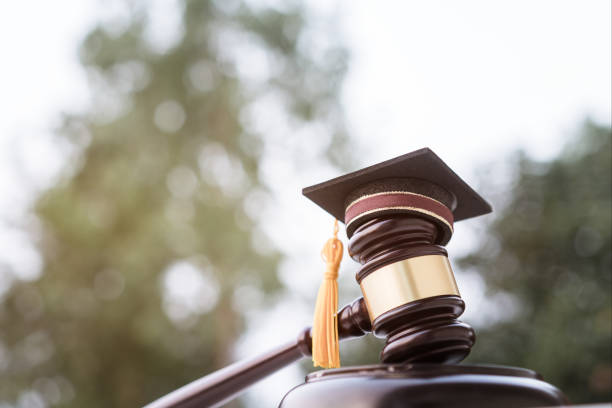 Graduation diploma hat / Judge gavel on school lawyer. Concept of graduate study international abroad about jurisprudence laws certificate in university, distance education for learning by self stock photo