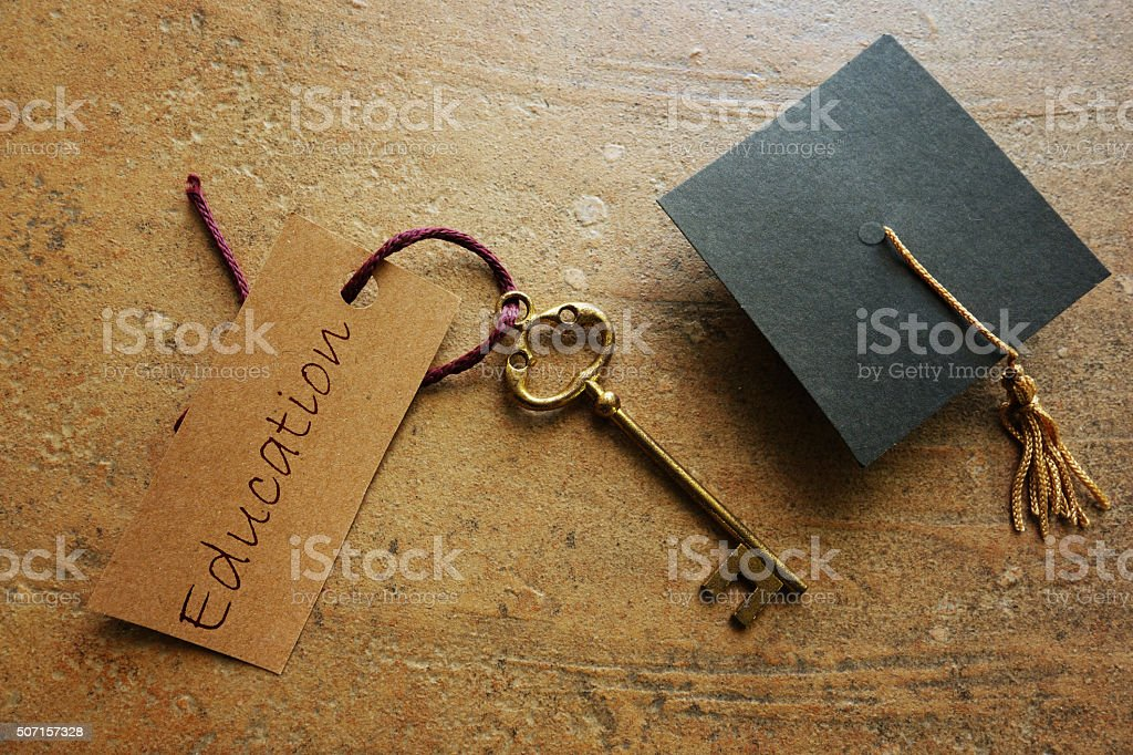 Graduation key to success stock photo
