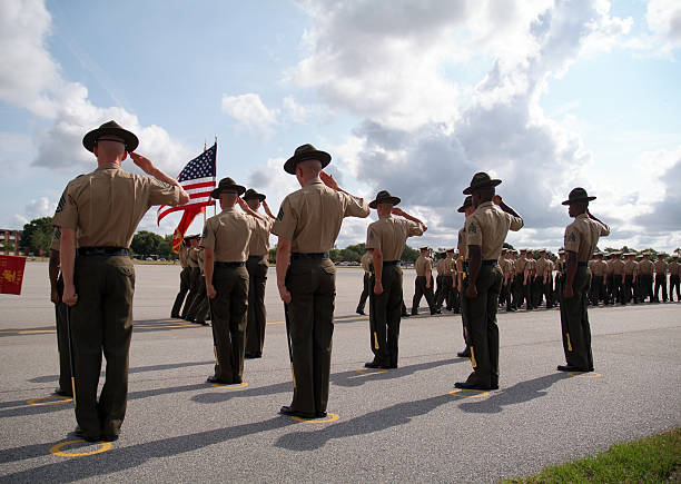 graduation of marines from parris island 02 - saluting stock photos and pictures