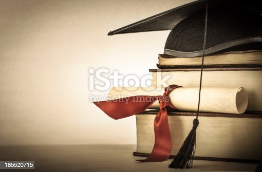istock Graduation Scroll and Book Stack 185520715
