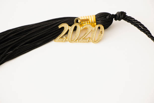 2020 Graduation Tassel 2020 Graduation Tassel close up with copyspace. tassel stock pictures, royalty-free photos & images