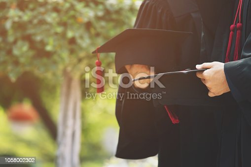 1127798356 istock photo graduation,Student hold hats in hand during commencement success graduates of the university,Concept education congratulation.Graduation Ceremony,Congratulate the graduates in University. soft focus 1058002302