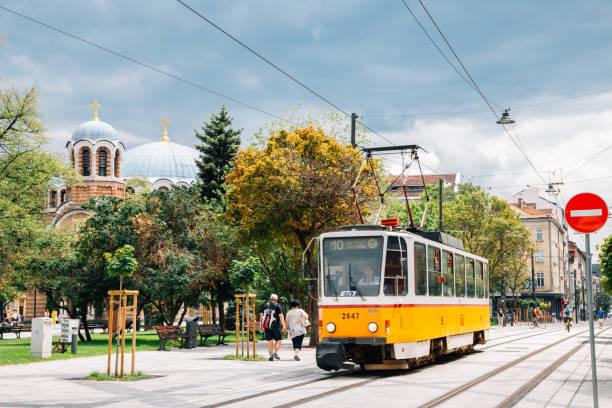 Graf Ignatiev street, Church of Sveti Sedmochislenitsi and old tram in Sofia, Bulgaria stock photo