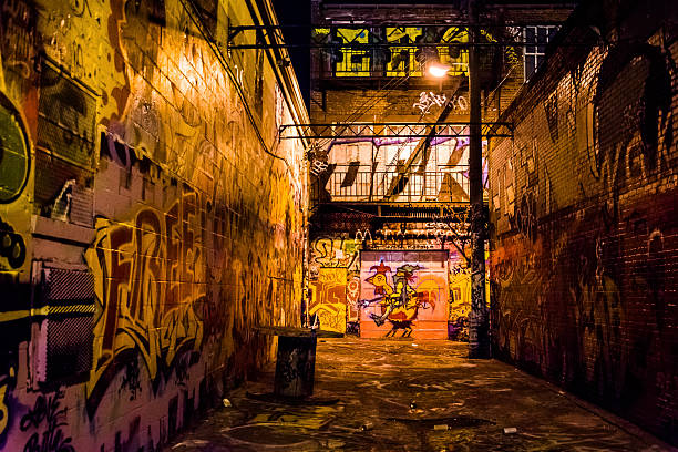 Graffiti Alley at night, in Baltimore, Maryland. stock photo