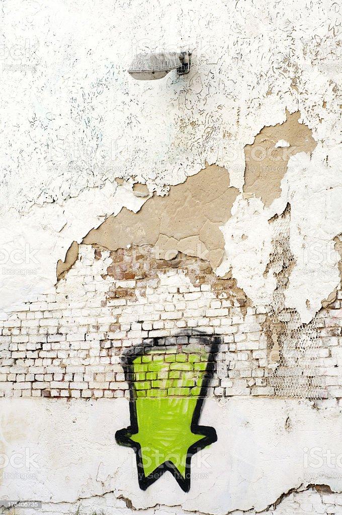Graffiti and a lamp post onto white brick wall royalty-free stock photo