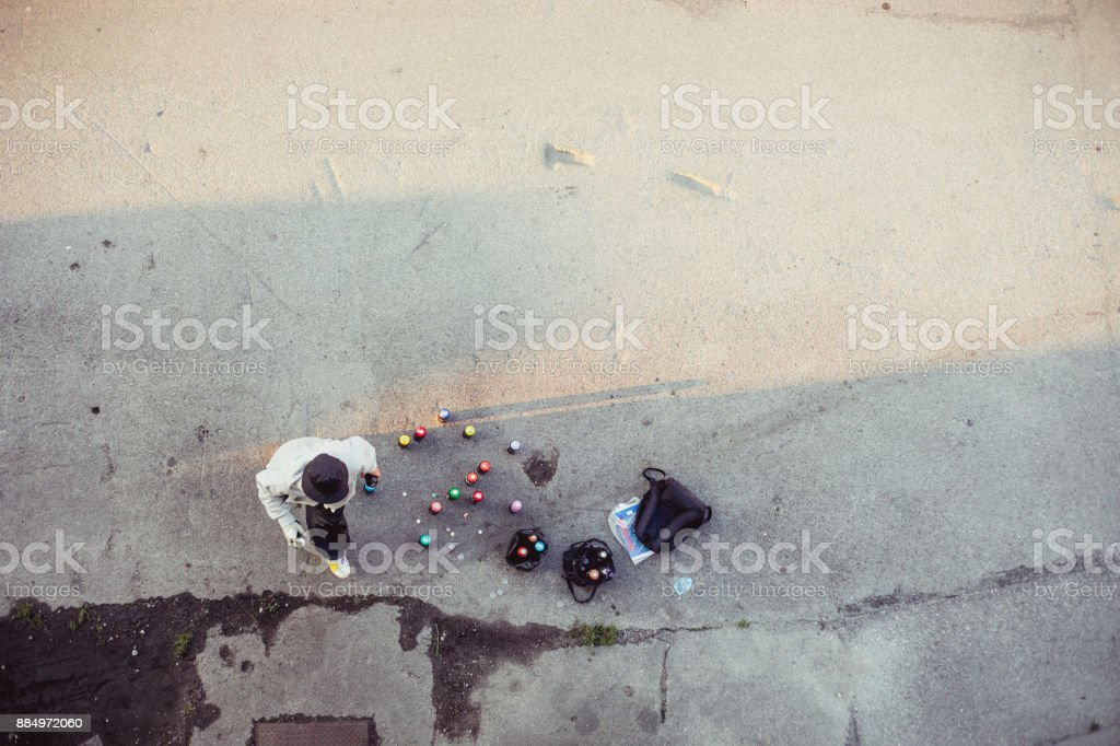 Graffiti Artist and his Spray Cans stock photo