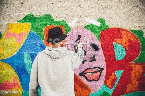 istock Graffiti Artist at Work 874327928