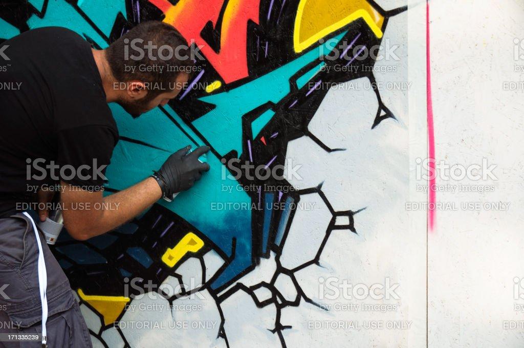 Graffiti artist is working royalty-free stock photo