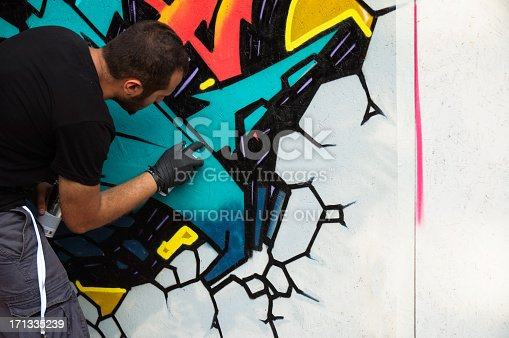 istock Graffiti artist is working 171335239
