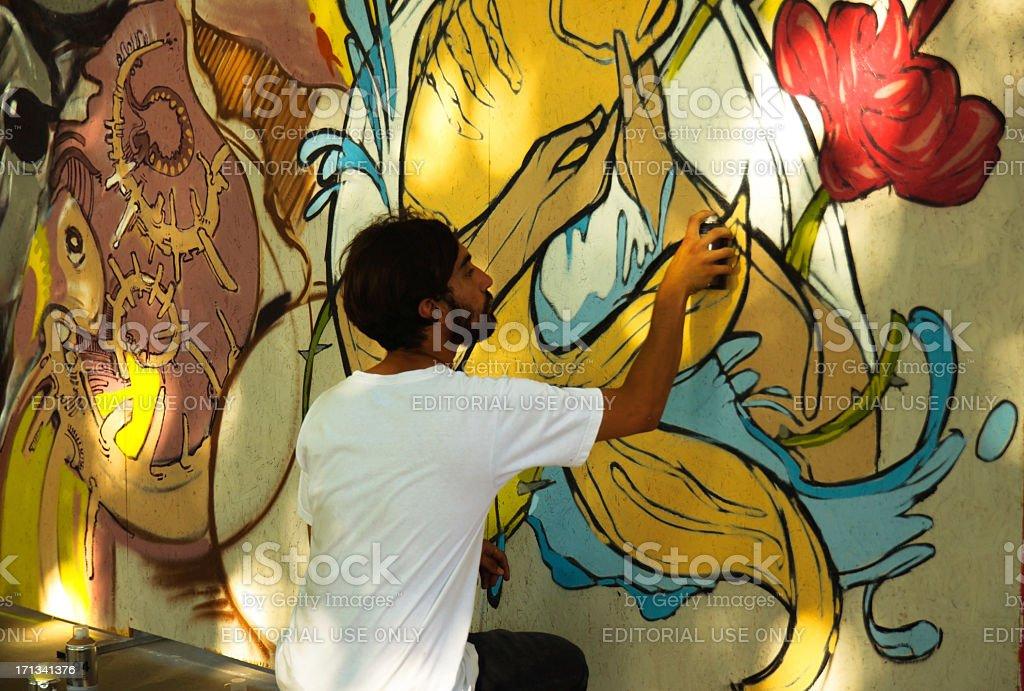 Graffiti artist is working stock photo
