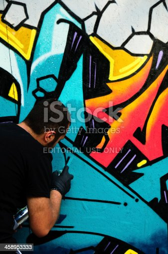 istock Graffiti artist is working 458953333