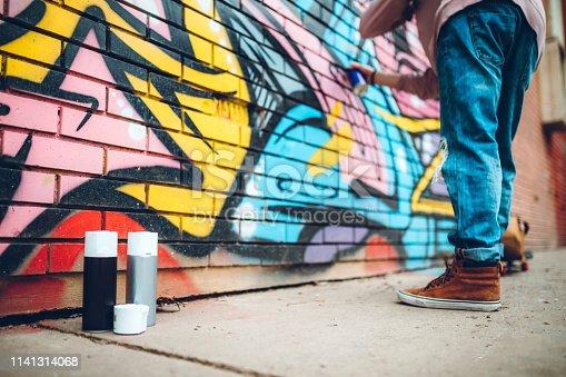 istock Graffiti artist with dreadlocks 1141314068
