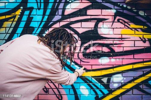 istock Graffiti artist with dreadlocks 1141314602